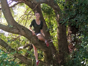 Climbing a tree in the gardens