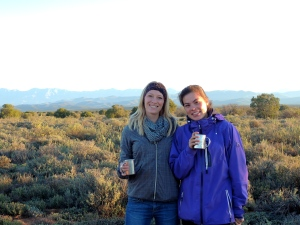 Thea and me enjoying a sunrise coffee before going out to the meerkat burrows