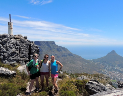 Emily, Thea, and me on top of Devil's Peak with Table Mountain and Lion's Head in the back!