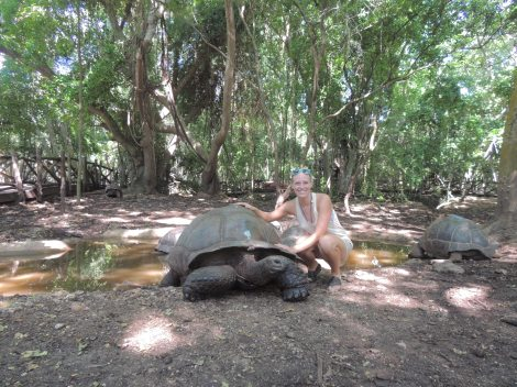 With the oldest tortoise at the sanctuary. She was born in 1858